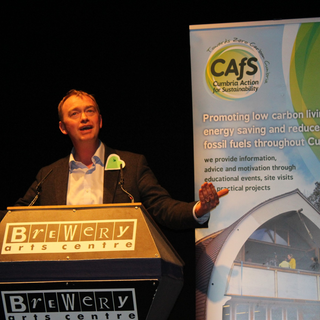 Tim Farron speaking at a climate change event