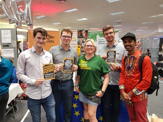 Mary Page and some young Green Lib Dems at the stall at Brighton 2018 (greenlibdems.org.uk)