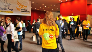libdems in lobby at a conference (from http://www.libdems.org.uk/conference_faqs)